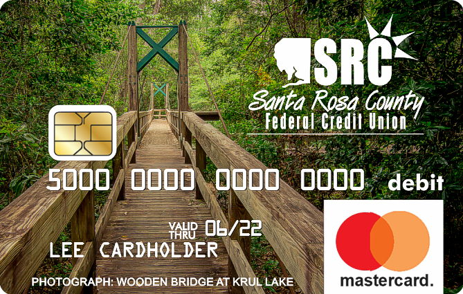 debit card with photo of bridge in a green forest