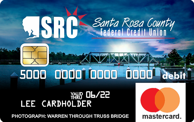 debit card with photo of boat dock on the water in the evening
